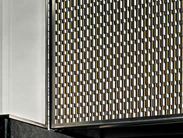 Stainless steel and brass type architectural rigid mesh is installed on the facade of building.