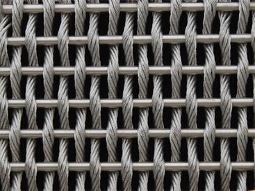 A piece of stainless steel cable metal mesh on the black background.