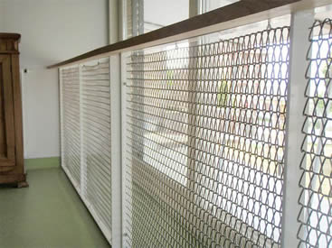 The balustrade on the balcony is made of conveyor belt mesh.