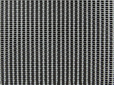 A piece of cable metal mesh on the black background with three cable steel wires.