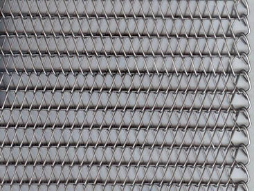 A piece of conveyor belt mesh with round spiral wires and straight wire rods.