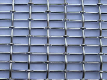 A piece of crimped architectural mesh with plain crimped warp wire and lock crimped weft wire.