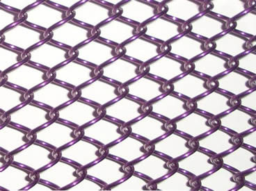 A piece of purple metal coil drapery on the white background.