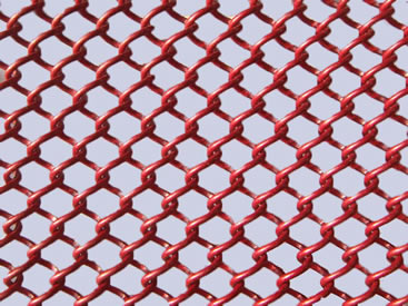 A piece of red metal coil drapery on the gray background.