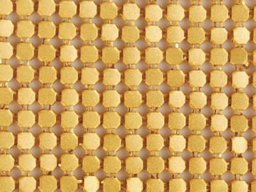 A piece of brass metallic fabric cloth with octagon shapes.